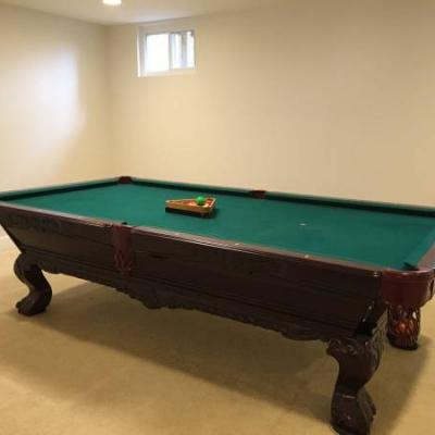 Beautiful Pool Table with Chair, Lamp, and Stick Holder and Counter